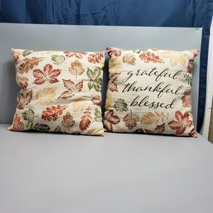 2 fall pillows with leaves
